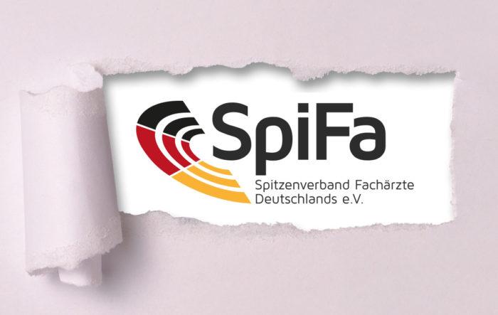 Hinter einem aufgerissenen Papier wird das SpiFa-Logo sichtbar